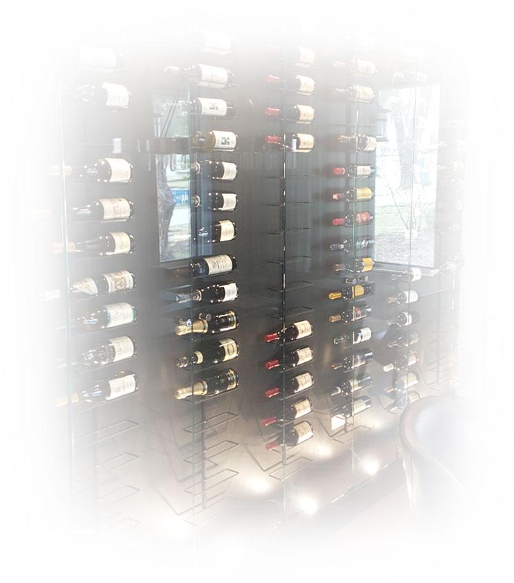 Walk in wine rack set behind a glass case.